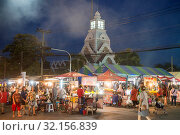 Купить «The colck tower with the streetmarket at the Phimai festival in the Town of Phimai in the Provinz Nakhon Ratchasima in Isan in Thailand. Thailand, Phimai, November, 2017», фото № 32156839, снято 2 апреля 2020 г. (c) age Fotostock / Фотобанк Лори