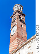 Travel to Italy - view of tall tower Torre dei Lamberti in Verona city in spring. Стоковое фото, фотограф Zoonar.com/Valery Voennyy / easy Fotostock / Фотобанк Лори