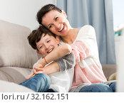 Купить «Happy woman hugging son», фото № 32162151, снято 28 марта 2019 г. (c) Яков Филимонов / Фотобанк Лори