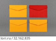 Купить «Four yellow and red paper envelopes over grey», фото № 32162835, снято 26 марта 2019 г. (c) Anton Eine / Фотобанк Лори