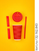 Купить «Red paper coffee cup over yellow», фото № 32162843, снято 28 марта 2019 г. (c) Anton Eine / Фотобанк Лори
