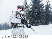 Купить «Winter arctic mountains warfare. Action in cold conditions. Trooper with weapons in forest somewhere above the Arctic Circle.», фото № 32165323, снято 21 сентября 2019 г. (c) easy Fotostock / Фотобанк Лори