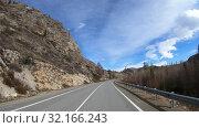 Купить «Driving along mountain road Chuysky Tract along Kurai Ridge on Altai at Spring season», видеоролик № 32166243, снято 3 июля 2019 г. (c) Serg Zastavkin / Фотобанк Лори