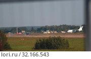Купить «29 AUGUST 2019 MOSCOW, RUSSIA: reactive dark fighter airplane is gaining speed on the runway», видеоролик № 32166543, снято 19 октября 2019 г. (c) Константин Шишкин / Фотобанк Лори