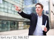 Купить «Male pointing finger at object», фото № 32166927, снято 20 апреля 2017 г. (c) Яков Филимонов / Фотобанк Лори