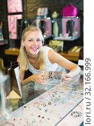 Купить «Woman buying bracelet in store», фото № 32166999, снято 6 августа 2020 г. (c) Яков Филимонов / Фотобанк Лори