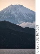 Купить «Mount Fuji summit in the clouds. Hakone area of Kanagawa Prefecture in Honshu. Japan», фото № 32167539, снято 1 декабря 2007 г. (c) Serg Zastavkin / Фотобанк Лори