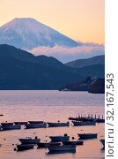 Купить «The view of Mount Fuji summit at the sunset over the Lake Ashi. Kanagawa Prefecture. Honshu. Japan», фото № 32167543, снято 1 декабря 2007 г. (c) Serg Zastavkin / Фотобанк Лори