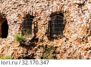 Купить «Windows with forged lattice at the medieval fortress», фото № 32170347, снято 8 августа 2018 г. (c) FotograFF / Фотобанк Лори