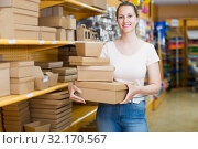 Woman housewife with other gift boxes. Стоковое фото, фотограф Яков Филимонов / Фотобанк Лори