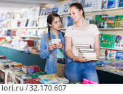 Schoolgirl chatting on screen tablet and shopping. Стоковое фото, фотограф Яков Филимонов / Фотобанк Лори