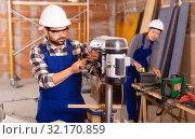 Купить «Man is worker behind drilling machine», фото № 32170859, снято 6 марта 2019 г. (c) Яков Филимонов / Фотобанк Лори