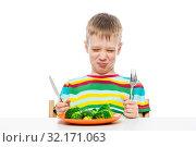 Grimace of a boy who does not like broccoli, portrait on a white background. Стоковое фото, фотограф Константин Лабунский / Фотобанк Лори