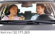 Купить «car driving school instructor teaching man driver», видеоролик № 32171263, снято 31 августа 2019 г. (c) Syda Productions / Фотобанк Лори