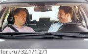 Купить «car driving school instructor talking to driver», видеоролик № 32171271, снято 31 августа 2019 г. (c) Syda Productions / Фотобанк Лори