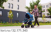 Купить «father with baby in stroller and coffee in city», видеоролик № 32171343, снято 1 сентября 2019 г. (c) Syda Productions / Фотобанк Лори