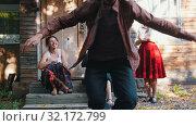 A woman playing the balalaika and a man dancing russian folklore dancing near the country house - bright sunlight. Стоковое видео, видеограф Константин Шишкин / Фотобанк Лори