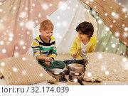 Купить «boys with pots playing music in kids tent at home», фото № 32174039, снято 18 февраля 2018 г. (c) Syda Productions / Фотобанк Лори