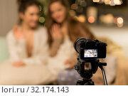 Купить «female bloggers with camera recording home video», фото № 32174143, снято 21 января 2018 г. (c) Syda Productions / Фотобанк Лори