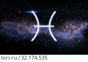 pisces zodiac sign over night sky and galaxy. Стоковое фото, фотограф Syda Productions / Фотобанк Лори