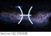 Купить «pisces zodiac sign over night sky and galaxy», фото № 32174535, снято 13 сентября 2019 г. (c) Syda Productions / Фотобанк Лори