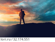 Купить «traveller standing on edge of hill over sunset», фото № 32174551, снято 31 августа 2014 г. (c) Syda Productions / Фотобанк Лори