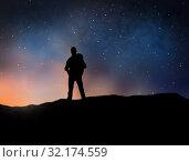 Купить «traveler standing on edge over night sky», фото № 32174559, снято 31 августа 2014 г. (c) Syda Productions / Фотобанк Лори