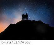 Купить «travelers on edge of mountain over night sky», фото № 32174563, снято 31 августа 2014 г. (c) Syda Productions / Фотобанк Лори