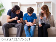 Купить «Concept of underage smoking with young boy and family», фото № 32175651, снято 28 мая 2019 г. (c) Elnur / Фотобанк Лори