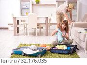 Купить «Young couple preparing for trip», фото № 32176035, снято 11 июня 2019 г. (c) Elnur / Фотобанк Лори