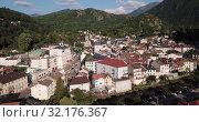 Купить «Aerial view of Ax-les-Thermes with buildings and The Lauze river in France, Midi-Pyrenees», видеоролик № 32176367, снято 19 июля 2019 г. (c) Яков Филимонов / Фотобанк Лори