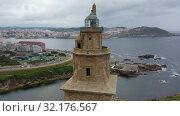 Купить «Aerial view of oldest Roman lighthouse in use today, La Coruna, Spain», видеоролик № 32176567, снято 19 июня 2019 г. (c) Яков Филимонов / Фотобанк Лори
