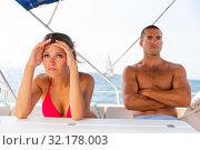 Купить «Upset girl with boyfriend on yacht», фото № 32178003, снято 19 сентября 2019 г. (c) Яков Филимонов / Фотобанк Лори