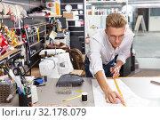 Купить «Dressmaker at work – creating pattern», фото № 32178079, снято 20 октября 2018 г. (c) Яков Филимонов / Фотобанк Лори