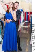 Купить «Family couple posing together in clothes shop», фото № 32178179, снято 11 апреля 2017 г. (c) Яков Филимонов / Фотобанк Лори