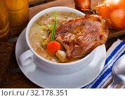 Купить «Lamb's soup cooked with pearl barley, green peas and cabbage», фото № 32178351, снято 17 ноября 2019 г. (c) Яков Филимонов / Фотобанк Лори