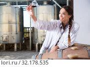 Купить «woman sommelier is tasting wine at wine factory», фото № 32178535, снято 15 сентября 2019 г. (c) Татьяна Яцевич / Фотобанк Лори