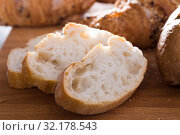 Купить «slices of wheaten bread on wooden surface», фото № 32178543, снято 30 января 2018 г. (c) Татьяна Яцевич / Фотобанк Лори