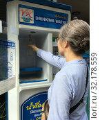 Купить «Woman by drinking water machine», фото № 32178559, снято 9 сентября 2019 г. (c) Александр Подшивалов / Фотобанк Лори