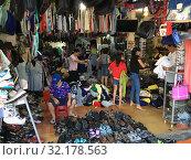 Купить «People buy clothes at second hand store», фото № 32178563, снято 21 октября 2018 г. (c) Александр Подшивалов / Фотобанк Лори