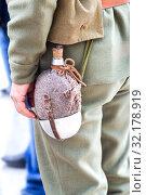 Купить «Vintage military flask hangs on a belt from a soldier», фото № 32178919, снято 6 октября 2018 г. (c) FotograFF / Фотобанк Лори