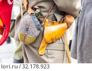 Купить «Vintage leather holster and other ammunition on the belt», фото № 32178923, снято 6 октября 2018 г. (c) FotograFF / Фотобанк Лори