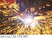 Gas plasma cutting. Metal machining with sparks on CNC maching. Стоковое фото, фотограф Дмитрий Калиновский / Фотобанк Лори