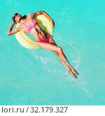 Купить «Women swim on yellow color buoys in the pool», фото № 32179327, снято 22 октября 2019 г. (c) Сергей Новиков / Фотобанк Лори