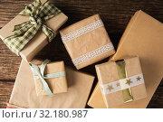 Купить «Simple wrapped gift on wooden table», фото № 32180987, снято 13 августа 2019 г. (c) Wavebreak Media / Фотобанк Лори