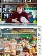 Glad selling sausage and ham at the counter. Стоковое фото, фотограф Яков Филимонов / Фотобанк Лори