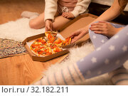 Купить «happy female friends eating pizza at home», фото № 32182211, снято 21 января 2018 г. (c) Syda Productions / Фотобанк Лори
