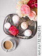 Купить «coffee, candles, garland and flowers on table», фото № 32182615, снято 11 апреля 2019 г. (c) Syda Productions / Фотобанк Лори