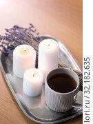 Купить «candles, tea in mug and lavender flowers on table», фото № 32182635, снято 12 апреля 2019 г. (c) Syda Productions / Фотобанк Лори