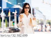 Купить «happy woman with takeaway coffee and lunch in city», фото № 32182699, снято 13 июля 2019 г. (c) Syda Productions / Фотобанк Лори